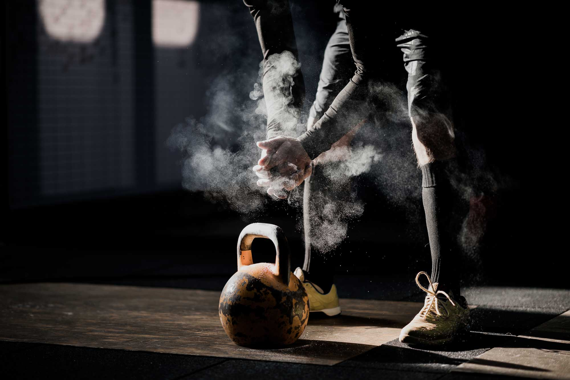 Man getting ready to lift kettlebell