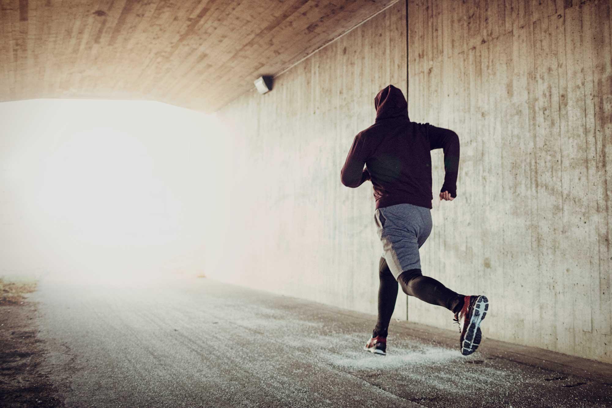 Runner in tunnel